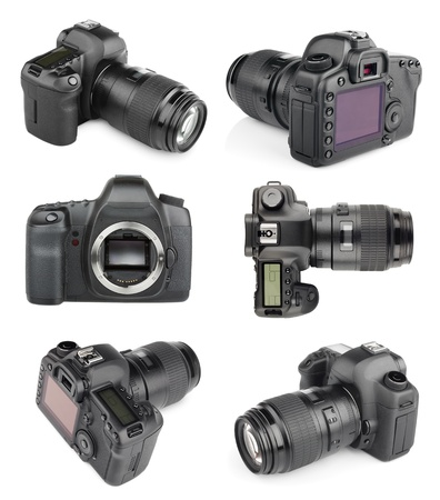 Collection of modern digital SLR 35mm cameras isolated on white with clipping path photo