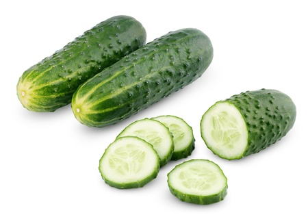 Sliced cucumber vegetable isolated on white with clipping path photo