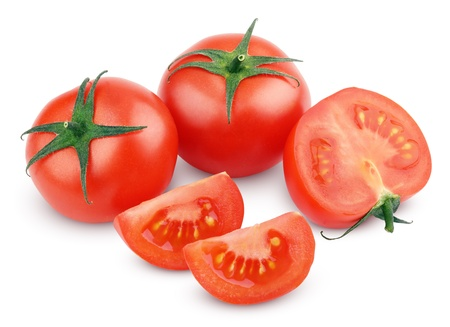 Sliced red tomato vegetables isolated on white with clipping path photo
