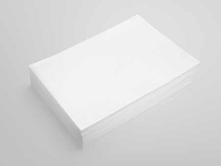 Stack of white paper on gray background with clipping path photo