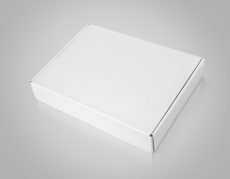 Closed blank carton box on gray background  photo