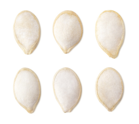 clipping  path: Set of single salted pumpkin seeds isolated on white with clipping path