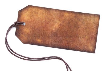 흰색 배경에 고립 된 빈 갈색 가죽 태그 스톡 콘텐츠 - 25285761