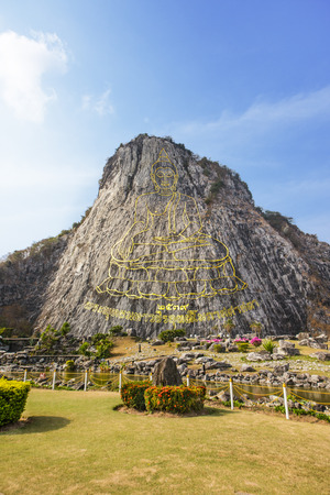 chonburi: 130 mtr high Buddha laser carved and inlayed with gold on Khao Chee Chan Cliff, Sattahip, Chonburi province, Thailand Stock Photo