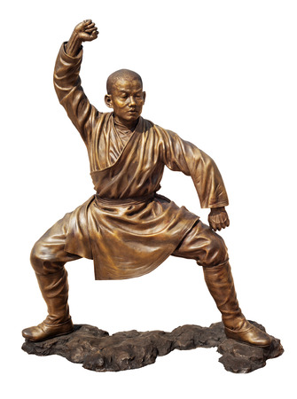 stance: Shaolin warriors monk in Chinese Temple Viharn Sien, Chonburi, Thailand. Bronze statue isolated on white with clipping path