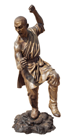 Shaolin warriors monk in Chinese Temple Viharn Sien, Chonburi, Thailand  Bronze statue isolated on white with clipping path photo