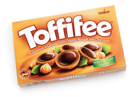 owned: Box of Toffifee candies isolated on white  Brand of caramel candies, owned by the Berlin-based German company August Storck