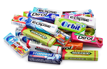 chewing gum: Heap of various brand chewing or bubble gum including Orbit, Dirol, Eclipse, Stimorol, Wrigley Spearmint and Doublemint isolated on white with clipping path Editorial