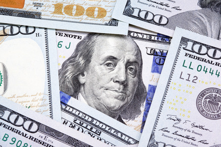 bank notes: Benjamin Franklin on the one hundred dollar bill framed by other banknotes Stock Photo