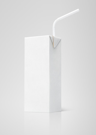 200 ml milk or juice white carton package with straw on gray background photo