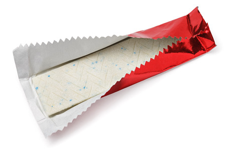 Chewing gum plate wrapped in red foil isolated on white with clipping path 版權商用圖片