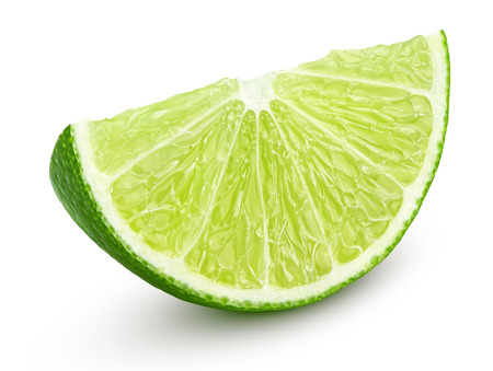 Slice of lime citrus fruit isolated on white background with clipping path photo