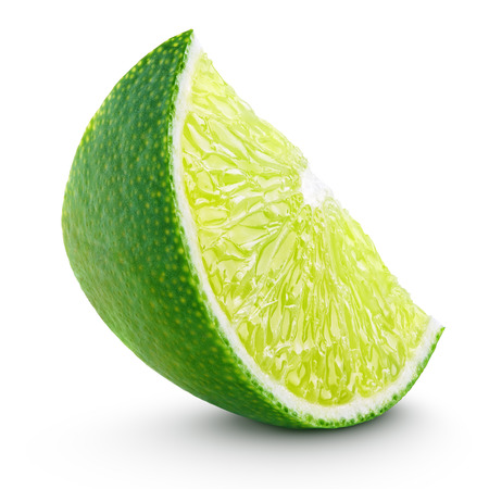 Slice of lime citrus fruit isolated on white background with clipping path