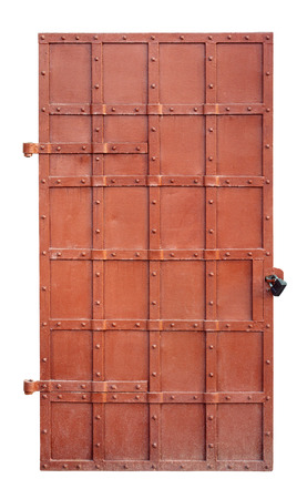 Closed big old door with rusty key isolated on white background with clipping path photo