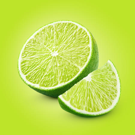 half cut: Half and slice of lime citrus fruit with clipping path Stock Photo