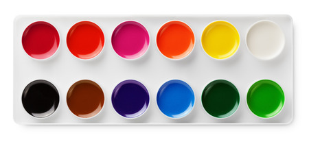 Top view of watercolor paints in box isolated on white background with clipping path