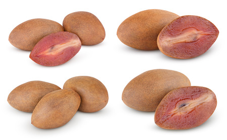 Set of sapodilla plums with cut isolated on white with clipping path photo