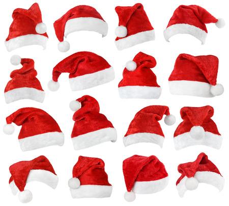 白い背景に分離されたサンタ クロースの赤い帽子のセット 写真素材