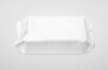 wipes: Wet wipes white package with flap on gray background Stock Photo