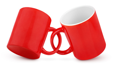 Two coupled red mugs isolated on white background with clipping path