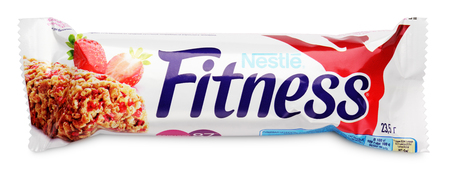 granola bar: MOSCOW, RUSSIA - FEBRUARY 1, 2017: Nestle Fitness (strawberry flavor) wholegrain cereal bar isolated on white background. Flapjack, muesli bar or granola bar with clipping path. Fitness Strawberry bar are produced by Nestle and Cereal Partners.