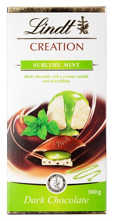 lindt: MOSCOW, RUSSIA - FEBRUARY 1, 2017: Top view of Lindt Creation sublime mint Swiss dark chocolate bar isolated on white background  Lindt chocolate bar made by Lindt & Springli AG
