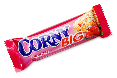 granola bar: MOSCOW, RUSSIA - FEBRUARY 1, 2017: Corny big (cranberry flavor) muesli bar isolated on white background. Flapjack, cereal bar or granola bar . Corny big are produced by Schwartauer Werke (Hero group). Editorial