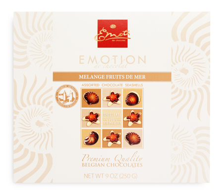 confiserie: TULA, RUSSIA - FEBRUARY 1, 2017: Top view of Emoti de Chocolat Melagne fruits de mer box - belgian seashells chocolate isolated on white. Emoti chocolate made by Elysberg Confiserie