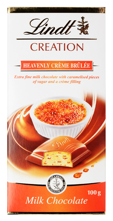 lindt: MOSCOW, RUSSIA - FEBRUARY 1, 2017: Top view of Lindt Creation Heavenly Crème Brûlée Swiss milk chocolate bar isolated on white with clipping path. Lindt chocolate made by Lindt & Sprüngli AG