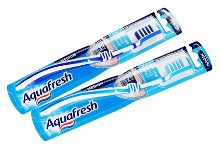 hygien: MOSCOW, RUSSIA - FEBRUARY 5, 2017: Top view of pair packaging Aquafresh toothbrushes isolated on white background