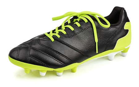 Single black leather football shoe or soccer boot isolated on white background with clipping path