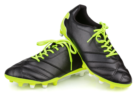 Pair of new unbranded black leather football shoes or soccer boots isolated on white background with clipping path