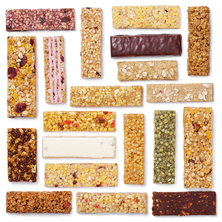 Top view of various healthy granola bars (muesli or cereal bar). Square set of protein bar isolated on white background Imagens - 79699845