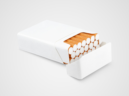 Opened pack of cigarettes lying on gray background Stock Photo