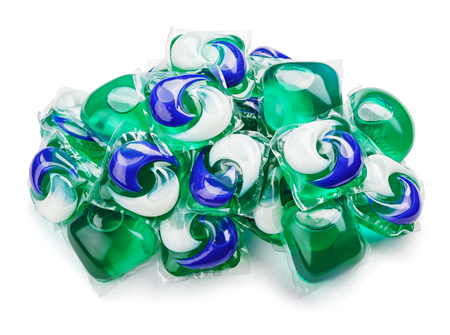 Pile of washing gel capsule pods with laundry detergent isolated on white background with clipping path Stock Photo