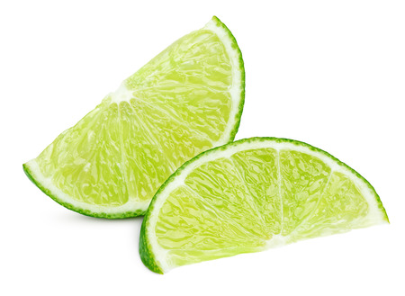lemon wedge: Two ripe slices of green lime citrus fruit isolated on white background with clipping path