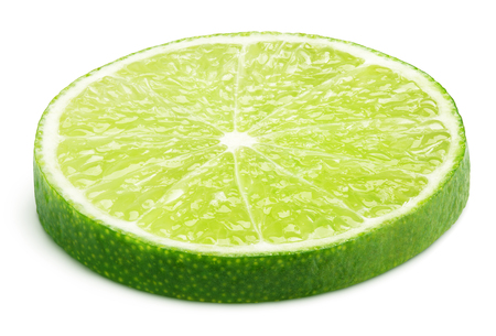 Slice of lime citrus fruit lying down isolated on white background with clipping path Banco de Imagens