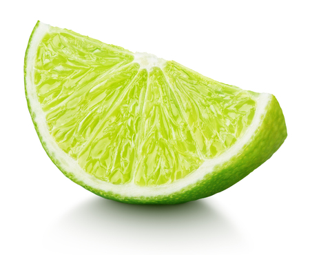 Ripe slice of green lime citrus fruit isolated on white background