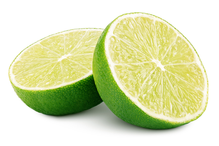 Two halves of green lime citrus fruit isolated on white background. Lime halves