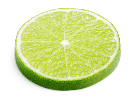 Slice of lime citrus fruit lying down isolated on white background with clipping path Stock Photo