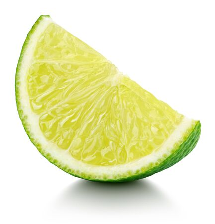 Ripe slice of lime citrus fruit isolated on white background. Lime wedge