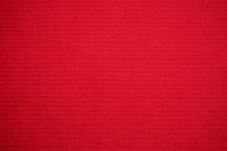 cross hatching: Red fabric background. Severe