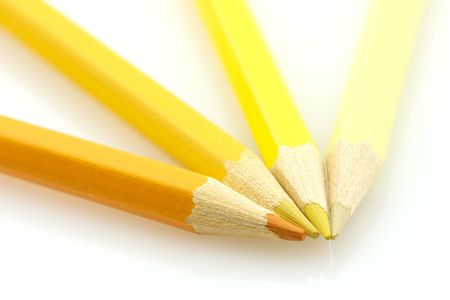 variously: Variously tinted yellow pencils on a white background Stock Photo