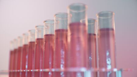 Science laboratory research. Development of medical technology. A breakthrough in biotechnology. Red liquid inside the test tube as fuel. Biotechnology, glassware flasks. Test tubes, 3D Illustration 版權商用圖片