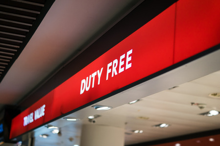 Red duty free shop sign inside of an international airport