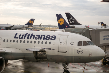 towed: Star Alliance Lufthansa Airbus A320 aircraft towed for maintenance at Frankfurt airport, Germany, February 2016