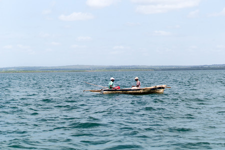 tanga: Two local fishermen in a small wooden boat in the Indian Ocean, off the coast of Tanga, Tanzania, Africa Editorial