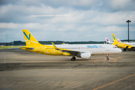 towed: TOKYO, JAPAN - circa JUNE 2016: Vanilla Air Aircraft towed at Narita International Airport, Japan. Vanilla Air is a low-cost airline newly founded in Japan and wholly owned by All Nippon Airways.