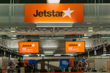 TOKYO, JAPAN - circa JUNE 2016: JetStar Japan ticket counter at Narita airport, Japan. Jetstar Airways, trading as Jetstar, is an Australian low-cost airline headquartered in Melbourne, Australia. JetStar Japan is their sister airline.