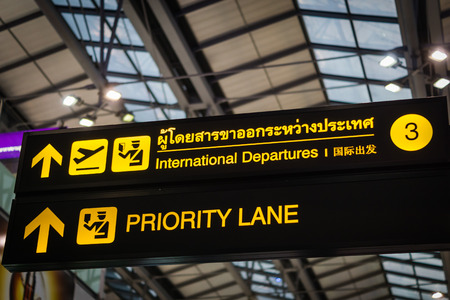priority: Priority Lane - illuminated yellow sign at airport